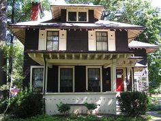 Other than the hearts on the shutters, I love this Arts and Crafts Style house. Totally my colors.