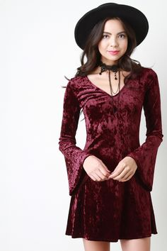 This mini dress is A-line silhouette with a slightly flared bottom. V-neckline. Long sleeves with flare bell sleeves. Stretchy velvet fabrication. Hook and loop choker necklace included. 92% Polyester