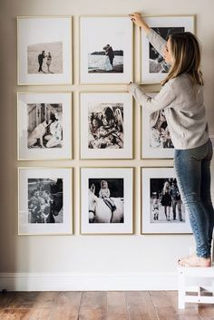 Picture frame wall that won't break the budget. Large, brass, high quality frames perfectly spaced out to create a beautiful space in your home.