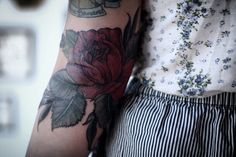 rose tattoo over the elbow, by alice carrier at anatomy tattoo in portland, oregon.