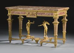 An Italian Carved and Marble-inlaid Giltwood Console Table, Genoa,  Late 18th Century with an inset rectangular alabastro a pecorella marble top within an egg-and-dart gilt-bronze border above two framed alabaster panels centred by a frieze with head of Medusa issuing two cornucopiae, each angle carved with a ram's head, on marble-inlaid tapering legs carved with acanthus leaves, joined by a shaped stretcher surmounted by two sculptures representing Venus and Eros, on foliate carved toupie…