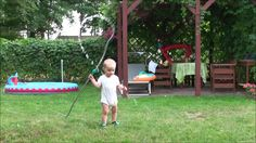 1,5 year old baby boy is watering the gras in the backyard and he is doing it in a very special way :) Funny & cute!