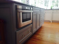 designed by michelle hampton of 84 lumber this purple island features wolf designer cabinets with custom paint  spacious kitchen by michelle hampton of 84 lumber   wolf designer      rh   pinterest com