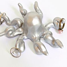 Learn how to make this easy octopus ring holder with only polymer clay and spray paint. A unique and cute way to display your rings!