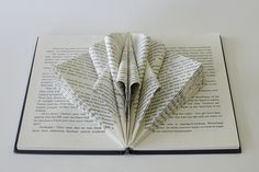 In this lesson, I'm going to teach you one of the basic folds in creating a book sculpture — the triangle fold — and how this simple fold can easily be modified to create interesting designs for your book sculptures. An array of triangle folds creates a simple but captivating design. Modify a series of …
