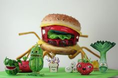 CHEESE BURGER SPIDER!! Cloudy with a chance of meatballs 2. My first cake ever without an ounce of fondant on it. Spider is all cake covered in modeling chocolate, characters are all modeling chocolate work, hand painted, no airbrushing. The spider is actually standing on only 3 of his 8 legs, no optical illusions.