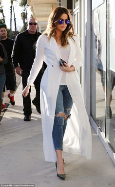 White hot! Khloe Kardashian was seen arriving at PiroFlipRC in Van Nuys, California on Tuesday donning long white outerwear over her casual attire