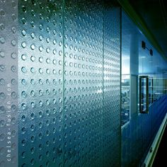 Kiln formed/cast architectural #glass has a unique tactile quality and has both decorative and structural uses from office partition screens to facades and cladding. Finishes and bespoke textures and patterns include smooth, #sandblasted (#frosted) and etched. The glass can be curved, formed and shaped. Unique designs, artistic finishes, colours and mirroring can be applied. Translucency from clear and transparent to opaque can be achieved. #architecture