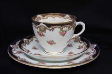 Crown Staffordshire Porcelain Co ltd, Minerva Works, Fenton, Staffordshire.  Edwardian tea trio with rose bud design and gilded detailing c 1910