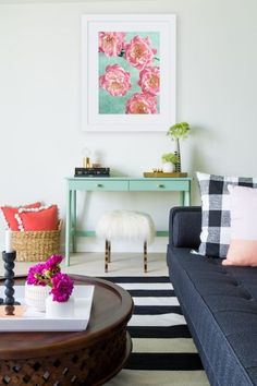 Patterns, bold colors and bright decor are the perfect pop of color in this pool house office.