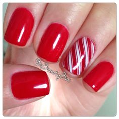 Christmas Candy Cane Nails.  Colors used:  Gelish - Hot Rod Red & Good Gossip.  Stamping Plate used:  Bundle Monster - BM423.  Stamping Polish:  Konad special polish in White.  #Holiday #Winter  #Festive