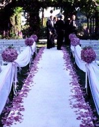 flowers along the side of the aisle so they don't get crushed. organza & ribbon to tie off seats so no one can enter by way of the aisle & mess up the flowers for the bride