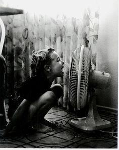 Childhood memories of summers in Indiana.  No air conditioning so a lot of time was spent in front of the fan singing songs and talking to myself to listening to the distortion of my voice.  :-)
