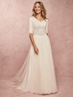 This soft and romantic modest wedding dress features an allover lace bodice with three-quarter sleeves, and a V-neckline. An attached beaded belt completes the sheath skirt, comprised of tulle. Finished with pearl buttons and zipper closure. Western Wedding Dresses, Modest Wedding Dresses, Designer Wedding Dresses, Bridal Dresses, Bridesmaid Dresses, Conservative Wedding Dress, Wedding Dress Sleeves, Dresses With Sleeves, Simple Wedding Dress With Sleeves