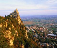 Republic of San Marino, smallest country in the world is surrounded by Italy. North of Rome and east of Florence. Try to go in 2013 Great Places, Places To See, Beautiful Places, Valentino Rossi, City Of San Marino, Republic Of San Marino, Tourist Information, Countries Of The World, Small Towns