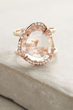 Details:  A modern ring with shimmering diamonds around a free-form topaz center. Handmade in Los Angeles by Sirciam using ethically sourced materials.  14k rose gold, topaz, diamond 0.15 CTW diamonds Handmade in the USA Style No. 40835779