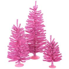 """These winning trees are an exciting hard-to-find designer pink color and feature a mixture of pink PVC and purple holographic laser tinsel tips that add extra sparkle! Product Features of 12"""" Tree: 69"""