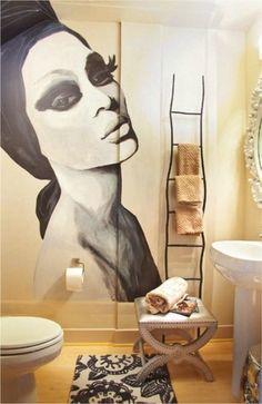 If your bathroom lacks shelves, use a stylish ladder to hang towels instead. I like the idea of choosing varying shades of towels in one tone for an ombre look.