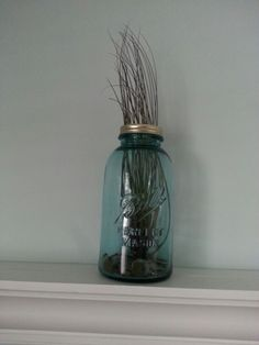 Florida themed bedroom.. vintage Mason jar with coins and an airplant