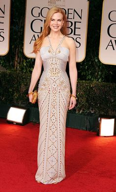 Nicole Kidman  Grade: B+    Nicole Kidman looked absolutely statuesque in this ultra-fitted Versace dress. Though the gown had a bit too much going on with the gold detailing, studded straps, and angular bodice cuts, there's no denying Kidman looked fab. She completed her ensemble with Fred Leighton gems, Manolo Blahnik heels, and a Roger Vivier clutch.