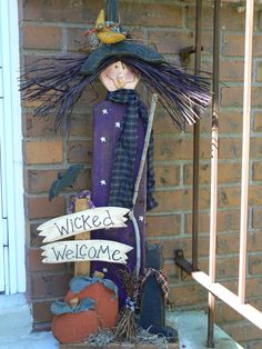 This wicked lady stands 34 tall. she is made of cedar fence boards, so she will hold up well in all types of weather. A fund easy porch