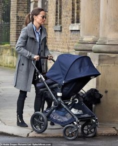 Pippa Middleton wearing Sandro Striped Shirt, Bugaboo Buffalo Stroller, Ray-Ban Round Metal Sunglasses, Burberry Belted Coat and Stuart Weitzman Jittermacho Boots