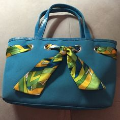 Turquoise cloth handbag Turquoise color handbag with green and teal scarf accent...approximately 8.5 wide, 2 inches deep, 7 inches tall. Frankie & Johnnie Bags Satchels