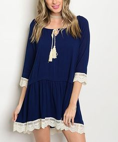 Bring flirty feminine style to your look with the tassel accent and lace trim on this breezy dress. Necklace not includedvSize S: 32'' long from high point of shoulder to hemModel (wearing size S): 5' 7'' tall; 34'' bust; 24'' waist; 34'' hips100% rayonMachine washMade in the USA
