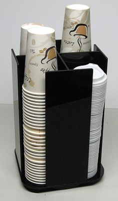 Spinning coffee cup and lid dispenser.
