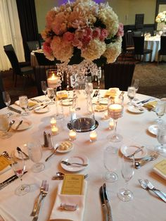 Centerpiece idea: Tall crystal vases filled with pink roses and fluffy white hydrangeas. Votive candles set a romantic mood | The VERVE Crowne Plaza Boston