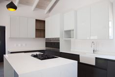 Located in a private cul de sac in Langebaan Country Estate, this home has spectacular views of the golf course, sports and other activities. Grey Gloss Kitchen, Gold Pendants, Wood Vinyl, Timber Wood, Country Estate, Kitchen Cupboards, Modern Industrial, Vinyl Flooring, Hanging Lights