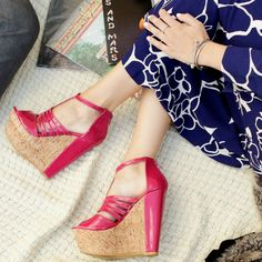 Gorgeous pink wedge shoes.