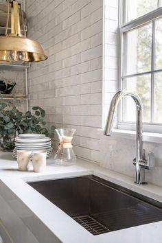 white subway tile backsplash // oversized sink