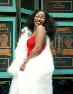 Chaka Khan's megawatt smile is the best accessory to complete her glamorous 70's swathed in fur style.