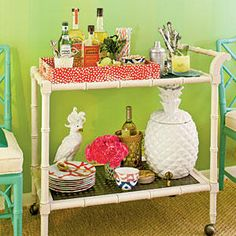 Chic Cocktail Cart - Handsome Bar Cart Ideas - Southernliving. A striking tray brings equal parts organization and beauty to this very fashionable bamboo bar cart. Hot pink carnations add a burst of color without crowding the utilitarian space.Love it? Get it!Bar cart: cbellfurnishing.com.Ceramic cockatoo: cashmerebuffalo.net.Tray: Square Dot Rectangular Tray