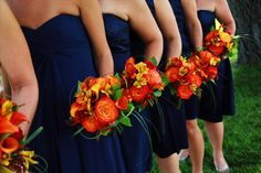 I like the color of the dresses! Perhaps make the flowers purple instead of orange.