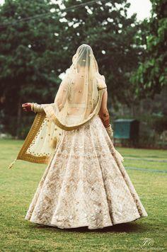 Browse photos, outfit & decor ideas & vendors booked from a real Punjabi /Sikh Modern & Stylish wedding in Delhi NCR. Designer Bridal Lehenga, Indian Bridal Lehenga, Dress Indian Style, Indian Dresses, Engagement Dresses, Wedding Dresses, Golden Lehenga, Marriage Dress, Wedding Story