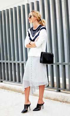 On Anne-Laure Mais of Adenorah: Theory sweater; Mango Striped Midi Skirt ($35) in Ice; Aldo Acaren Shoes ($25) in Black; Saint Laurent Betty Bag ($2,350) in Black; Triwa sunglasses; Daniel Wellington watch