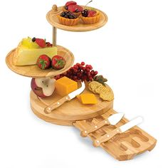 Create a stunning display at your next dining event with this rubberwood cheese serving set. The set features sturdy wooden construction and easy-to-use trays that swivel outward to allow guests easy access to cheese, breads, fruit, and other foods.