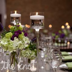 Candles and bunches of flowers topped the tables.