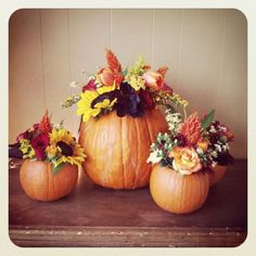 Maybe for centerpieces?? Seems easy enough to make, dad's good at hollowing out pumpkins and goes with the October theme!