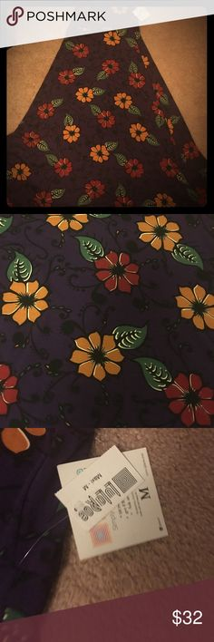 NWT LuLaRoe Maxi skirt size medium NWT Maxi skirt cotton feeling material. Beautiful eggplant background with squash and brick color flowers. Much prettier in person. LuLaRoe Skirts Maxi