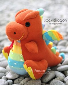 DIY Sock Dragon Sewing Pattern   I might try this with mylar stuffed  sewn into the wings for a tactile baby toy.  Could also add a rattle in the belly or squeakers in the large feet.