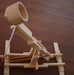 A catapult is a device that flings or hurls an object a long distance, usually with great force. Catapults date back to around 399 BC. and were...