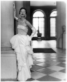 Sophie Malgat Litvak wearing dress Jacques Fath F/W 1949-1950 by Henry Clarke.