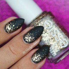 A matte glitter gradient nail art perfect for New years eve