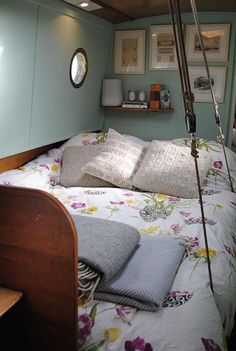 London Canal Boat Transformation - Designer Furniture at Designer Living // adorable - I love the wild flower bedcovers & pictures and little shelf in the corner