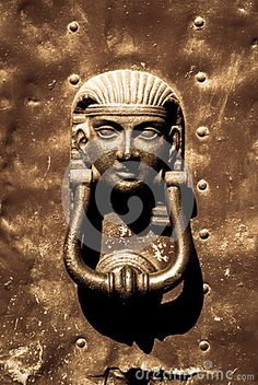 Photo about Old bronze Egyptian doorknocker mounted ona dented metal plate with studs on the exterior of a door. Image of hinged, knock, architectural - 26063917 Door Knobs And Knockers, Knobs And Handles, Door Handles, Old Doors, Windows And Doors, Gate Hinges, Ancient Art, Ancient Egypt, Door Accessories