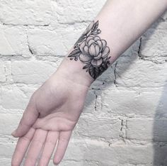 Black and Grey ink Floral Wrist Tattoo by Anna Bravo