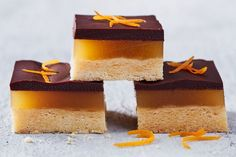 We've given the English classic Jaffa Cake a uniquely Aussie twist by turning it into a triple-layered slice. With a biscuit base, orange jelly middle and dark chocolate ganache topping, there's something for everyone. Jelly Recipes, Sweet Recipes, Cake Recipes, Dessert Recipes, Drink Recipes, Jaffa Kuchen, No Bake Slices, Cake Slices, Jelly Cheesecake